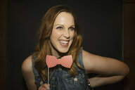 Portrait playful, confident female millennial with bow tie prop - HEROF14520
