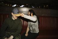Playful, silly millennials in nightclub - HEROF14526