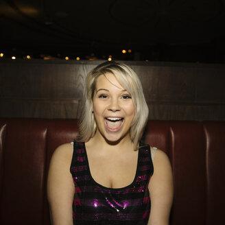 Portrait confident, enthusiastic, playful female millennial in nightclub - HEROF14547