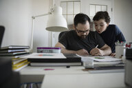 Father and son drawing in home office - HEROF14847