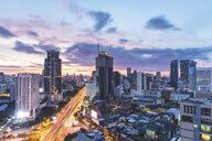 Thailand, Bangkok, aerial view of highway and skyscrapers in the city at sunrise - WPEF01358
