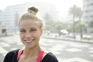 Portrait of smiling blond woman outdoors - ECPF00324