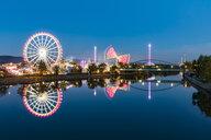 Germany, Stuttgart, Bad Cannstatt, fairground rides at Cannstatter Wasen at iver Neckar - WDF05064