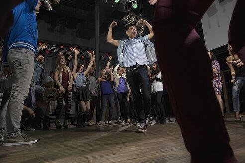 Crowd cheering and watching dancers in nightclub - HEROF14882