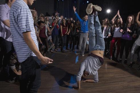 Crowd cheering and watching break dancer in nightclub - HEROF14885