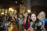 Enthusiastic friends cheering at bar - HEROF14918