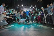 Crowd watching and cheering break dancers - HEROF14927