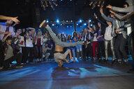 Crowd watching and cheering break dancer - HEROF14930