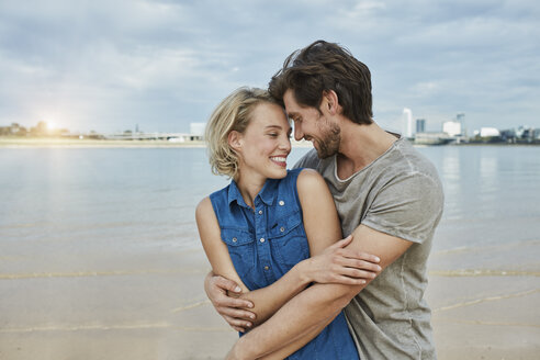 Happy young couple hugging at the riverbank - RORF01677
