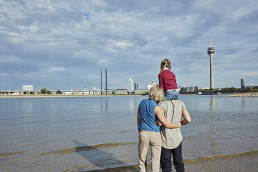 Germany, Duesseldorf, family with daughter standing at Rhine riverbank - RORF01698