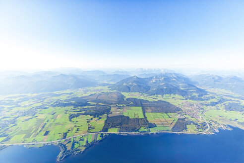 Germany, Bavaria, Chiemgau, Aerial view of Lake Chiemsee, Alps, A9 motorway and Bernau, Kampenwand and Alps in the background - MMAF00803