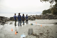 Eco-friendly scientists on rugged beach - HEROF15168