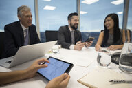 Business people talking, using digital tablet in conference room meeting - HEROF15252