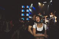 Laughing, happy couple enjoying music concert at nightclub - HEROF15678