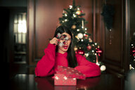 Portrait of teenage girl with Christmas present - ACPF00419
