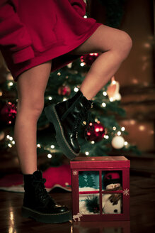 Legs of teenage girl with Christmas present - ACPF00425