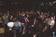 Milennials dancing and partying on nightclub dance floor - HEROF15786