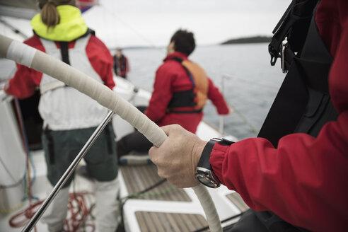 Man steering sailboat - HEROF15876