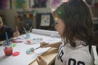 Preschool girl painting in art class - HEROF15990