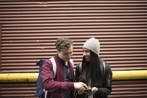 Young couple texting with smart phone - HEROF16275