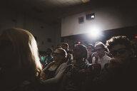 Tween friends in 3d glasses watching movie in dark movie theater - HEROF16392