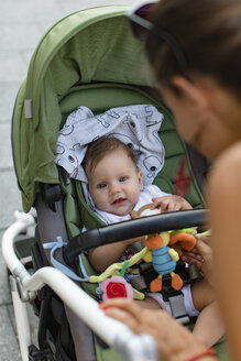 Mother and her baby in a stroller - MOMF00614