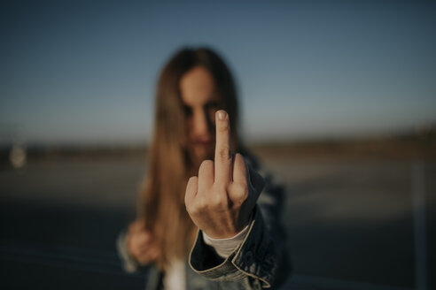Pozoblanco, Cordoba, Spain, Urban girl showing middle finger, youth culture - DMGF00029