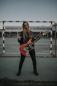 Pozoblanco, Cordoba, Spain, Rocker girl with a red guitar, musician - DMGF00050
