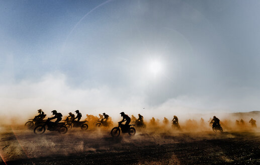 Group of motocross motorcycles coming out in the race. Image taken in Lleida Spain. - OCMF00252