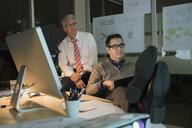 Businessmen working late in office - HEROF16703