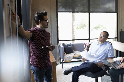 Businessmen strategizing in office meeting - HEROF16841