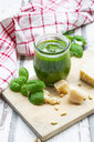 Glass of homemade pesto Genovese, ingredients and kitchen towel - LVF07748