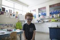 Smiling, innocent preschool boy in classroom - HEROF16976