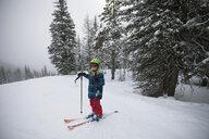 Boy skier skiing in snow - HEROF17993