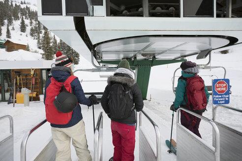 Female skier friends waiting for ski lift - HEROF18086