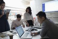 Designers working in creative office meeting - HEROF18248