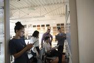 Designers brainstorming, meeting at whiteboard in creative office - HEROF18251