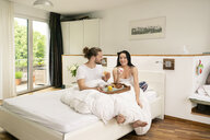Affectionate couple having breakfast in bed - PESF01210
