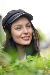 Portrait of a young woman with cap, smiling - PESF01255
