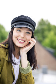 Portrait of a young woman with cap, smiling - PESF01258