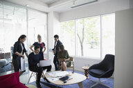Architects using laptop in office lounge meeting - HEROF18345