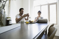 Couple enjoying breakfast at dining table - HEROF18474