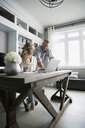 Couple working at laptop in home office - HEROF18507