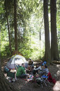 Friends talking and eating at campsite - HEROF18624