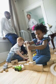Girl stacking wood blocks enjoying play date - HEROF18762