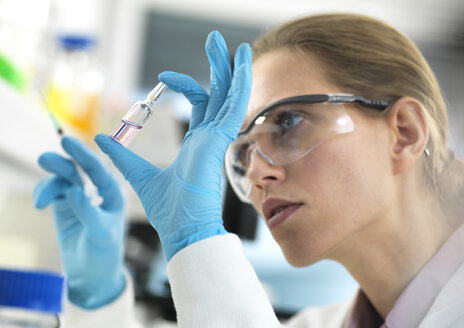 Pharmaceutical Research, Scientist preparing a new drug for testing in the laboratory - ABRF00317