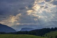 Rays of light break through clouds, Dolomites, Italy - RUEF02091