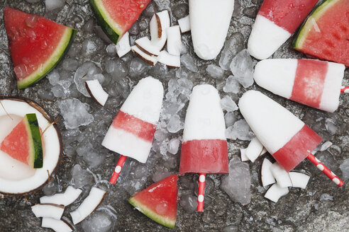 Homemade watermelon coconut ice lollies on crushed ice - GWF05846