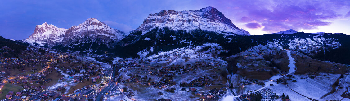 Switzerland, Canton of Bern, Wetterhorn, Grindelwald, townscape at blue hour in winter - AMF06758