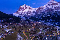 Switzerland, Canton of Bern, Wetterhorn, Grindelwald, townscape at blue hour in winter - AMF06761